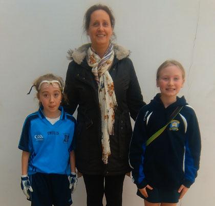 St Joseph's PS Lisburn 's Hannah Gartland u/11 Antrim Allianz Cumann na mBunscol Champion with u/13 Champion Niamh McNamara (left) from Good Shepherd with teacher Mrs Gartland