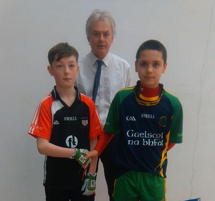 Antrim Allianz Cumann na mBunscol Handball Co-ordinator John Finch with u/13 Champion Lorcan McPhilips from Gaelscoil na bhfal and runner up Caolan McGee from Holy Cross.