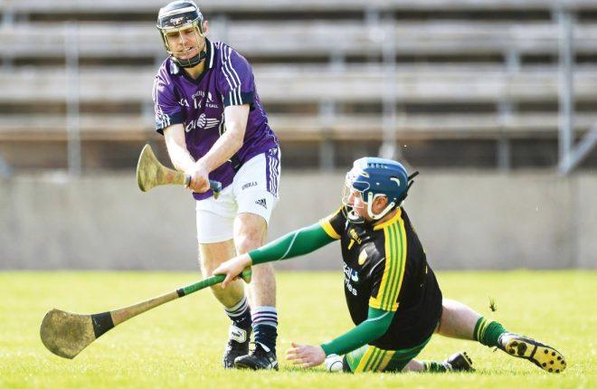 Donegal hurler Paul Burns, right